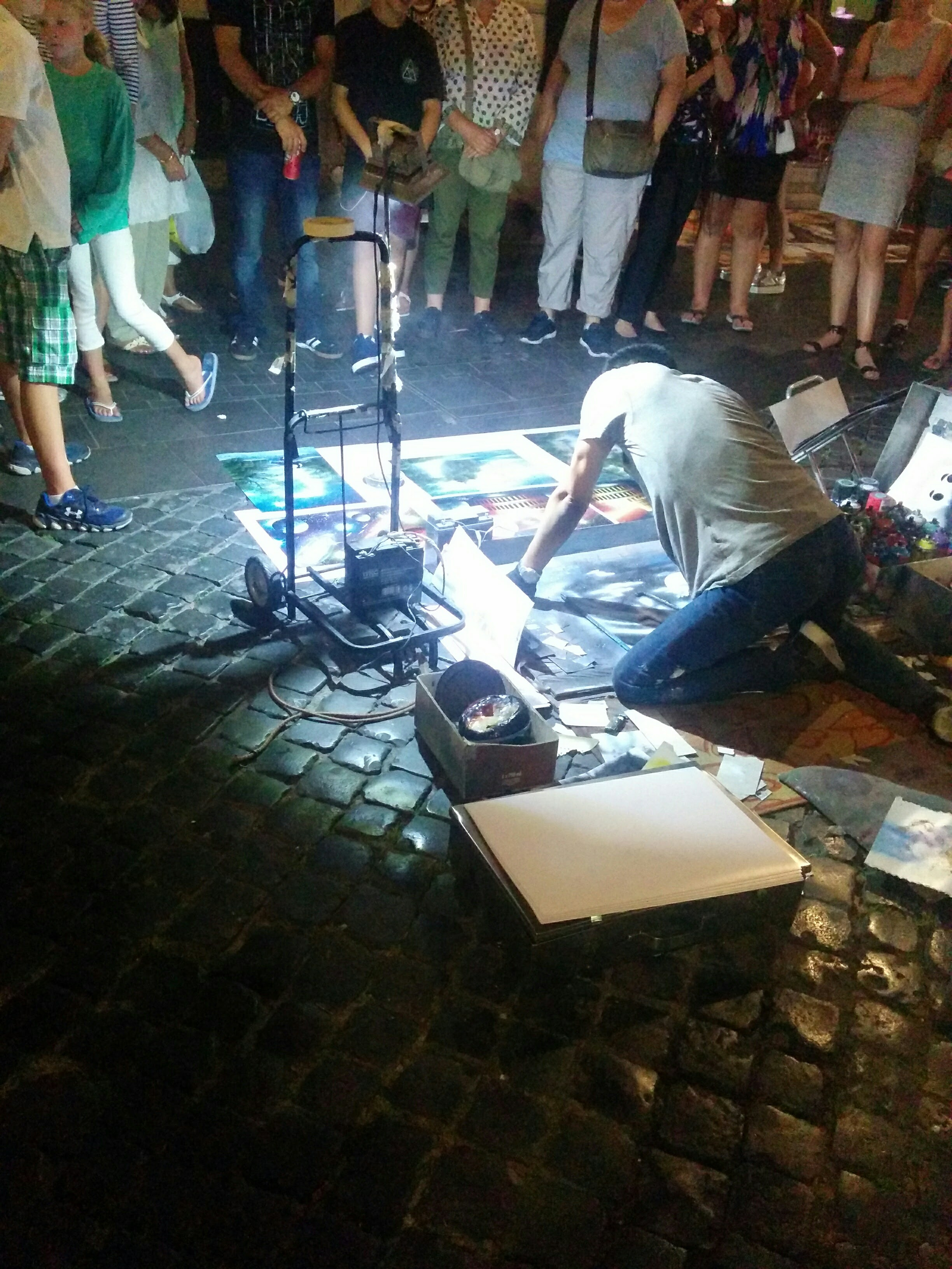 A street painter making spray paint art. It was cool until I realized there were about 5 other people doing the exact same thing :P