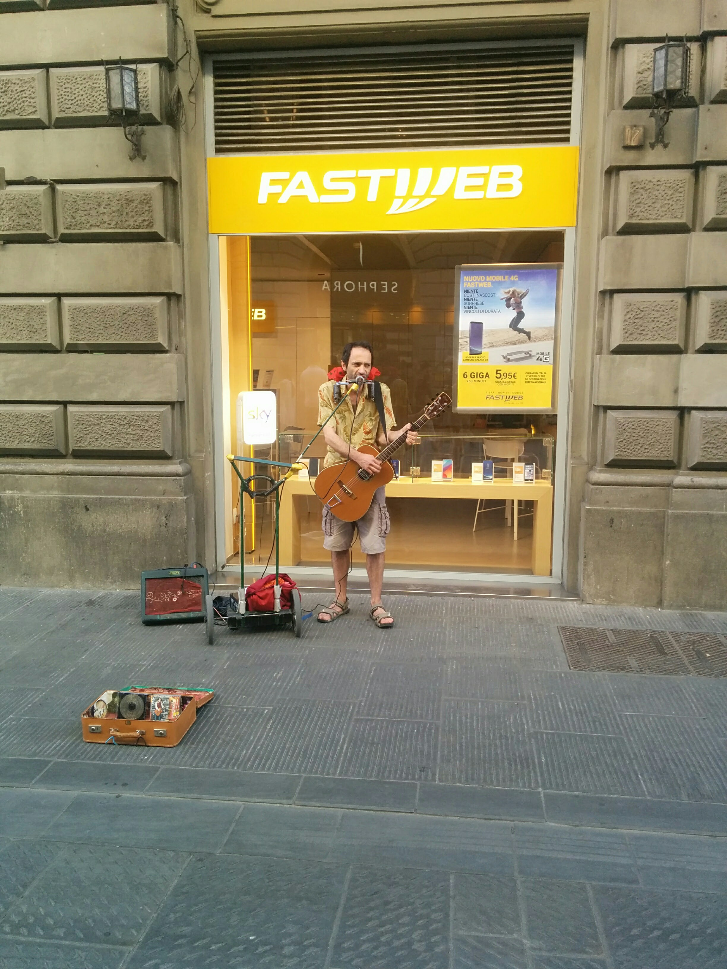 A street performer combining synthesizers with his guitar & voice
